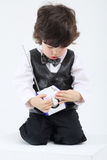 Little boy sits and studies portable radio with antenna Royalty Free Stock Images