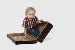 Little boy sits in suitcase Royalty Free Stock Photography