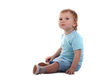 Little boy sitting. Isolated on the white Stock Images