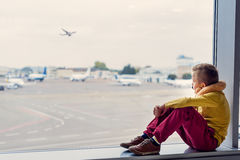 Little boy sitting at airport Royalty Free Stock Photo