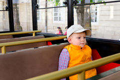 Little boy sitting alone in a bus Royalty Free Stock Image