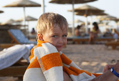 Little boy sitting on the beach Royalty Free Stock Photos