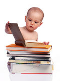 Little boy sitting behind a stack of books Royalty Free Stock Photos