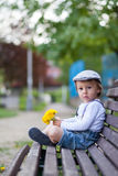 Little boy, sitting on a bench Royalty Free Stock Photo