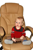 Little boy sitting in big armchair. Royalty Free Stock Images