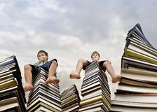 Little boy sitting on  books Royalty Free Stock Image