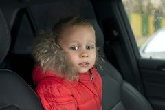 Little boy is sitting in the car Royalty Free Stock Photo