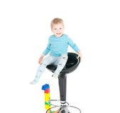 Little boy sitting in a chair Royalty Free Stock Images