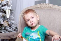 Little boy sitting on the chair Stock Images