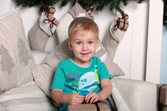 Little boy sitting on a chair Royalty Free Stock Image