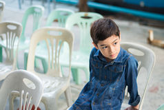 Little boy sitting on the chair jean shirt fashion Stock Image