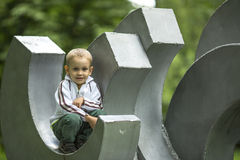 Little  boy is sitting in the children's park playground. Royalty Free Stock Image