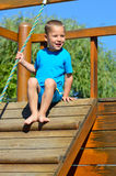 Little boy sitting on a climbing tower Royalty Free Stock Photos