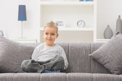 Little boy sitting at couch Royalty Free Stock Images