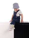 Little boy sitting on the cubes. Little boy sitting on the black and white cubes Stock Photos
