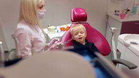 Little boy sitting in the dentists office.