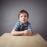 Boy sitting at desk Royalty Free Stock Image