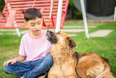 Little boy sitting with dog. Friendship Royalty Free Stock Images