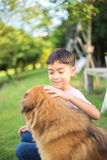 Little boy sitting with dog friendship Royalty Free Stock Photos