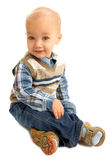 Little boy sitting on  a floor Royalty Free Stock Images