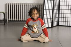 Little boy sitting on the floor Royalty Free Stock Image