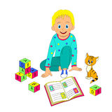 Little boy sitting on the floor looking at the letters in the bo Stock Image