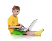 Little boy is sitting on the floor Royalty Free Stock Images