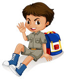 Little  boy sitting by his backpack Royalty Free Stock Images