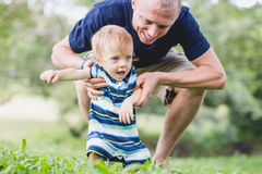 A little boy sitting on his father, balancing Royalty Free Stock Image