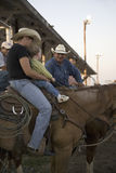 Little boy sitting on horse with cowboy at PRCA Rodeo Royalty Free Stock Photo