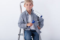 Little boy sitting on ladder Royalty Free Stock Photo