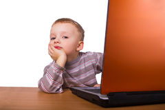 Little boy sitting at a laptop Stock Photography