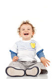 Little boy sitting and laughing Royalty Free Stock Photography
