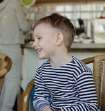 Little boy sitting laughing Stock Photography
