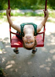 Little Boy Sitting On A Swing Stock Photography
