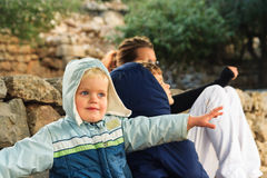 Little boy, sitting outdoor with his brother and mother, showing the plane, playing and dreaming of being pilot Royalty Free Stock Photography
