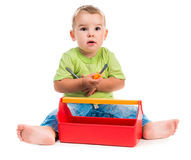 Little boy sitting and playing Stock Images