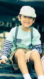 Little boy sitting at the restuarant vintage Royalty Free Stock Image