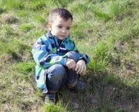 Little boy sitting and sad Stock Photos