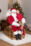 Santa claus and little boy stock images