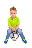 Little boy sitting on a soccer ball Royalty Free Stock Photography