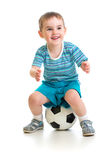 Little boy sitting on soccer ball isolated Royalty Free Stock Image