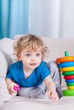 Little boy sitting on the sofa Royalty Free Stock Image
