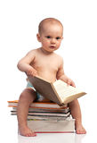 Little boy sitting on a stack of books Royalty Free Stock Image