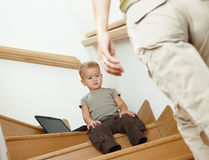 Little boy sitting on stairs Stock Image