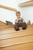 Little boy sitting on stairs Stock Photography