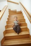 Little boy sitting on stairs Royalty Free Stock Images