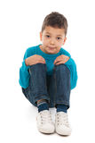 Little boy sitting in studio Royalty Free Stock Photo