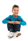 Little boy sitting in studio Royalty Free Stock Image