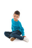 Little boy sitting in studio Stock Images